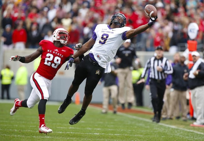 Nov 23, 2013; Raleigh, NC, USA; East Carolina Pirates wide receiver Chris Worthy (9) cannot make the catch behind North Carolina State Wolfpack defensive back Jack Tocho (29) during the 2nd quarter at Carter Finley Stadium. Mandatory Credit: James Guillory-USA TODAY Sports