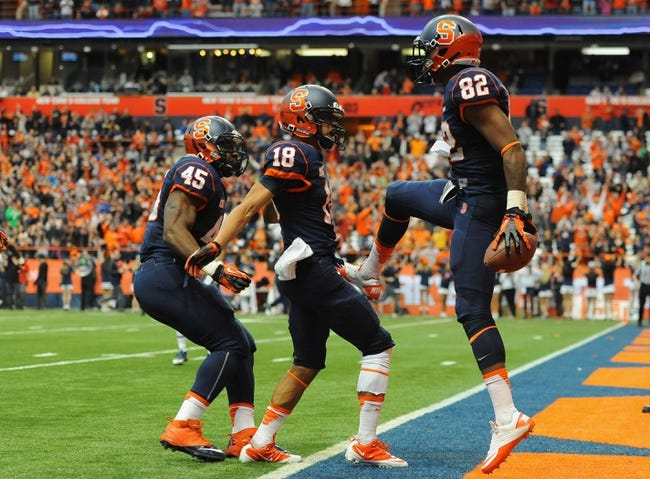 Nov 23, 2013; Syracuse, NY, USA; Syracuse Orange wide receiver Alvin Cornelius (82) celebrates his touchdown in the third quarter with wide receiver Christopher Clark (18) and running back Jerome Smith (45) against the Pittsburgh Panthers at the Carrier Dome.  Mandatory Credit: Rich Barnes-USA TODAY Sports