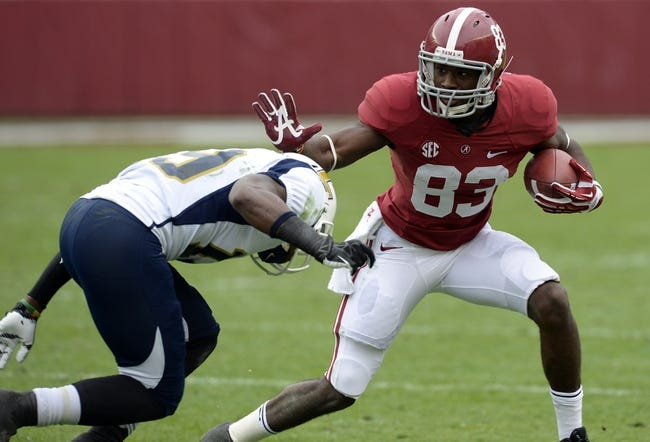 Nov 23, 2013; Tuscaloosa, AL, USA; Alabama Crimson Tide wide receiver Kevin Norwood (83) carries the ball against Chattanooga Mocs defensive back Dee Virgin (19)  during the first quarter at Bryant-Denny Stadium. Mandatory Credit: John David Mercer-USA TODAY Sports