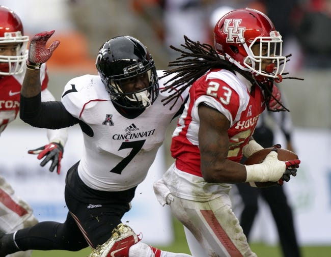 Nov 23, 2013; Houston, TX, USA; Houston Cougars defensive back Trevon Stewart (23) recovers a fumble and returns it for a touchdown during the third quarter as Cincinnati Bearcats running back Tion Green (7) attempts to make a tackle at BBVA Compass Stadium. Mandatory Credit: Troy Taormina-USA TODAY Sports