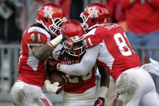 Nov 23, 2013; Houston, TX, USA; Houston Cougars defensive back Trevon Stewart (23) is congratulated by linebacker Steven Taylor (41) and defensive end Tyus Bowser (81) after returning a recovered fumble for a touchdown during the third quarter against the Cincinnati Bearcats at BBVA Compass Stadium. Mandatory Credit: Troy Taormina-USA TODAY Sports