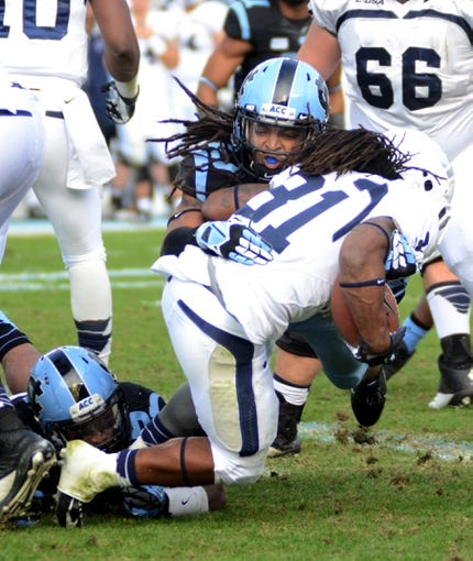 Nov 23, 2013; Chapel Hill, NC, USA; North Carolina Tar Heels safety Tre Boston (10) tackles Old Dominion Monarchs running back Cam Boyd (31) during the second half at Kenan Memorial Stadium. The Tar Heels won 80-20.  Mandatory Credit: Rob Kinnan-USA TODAY Sports
