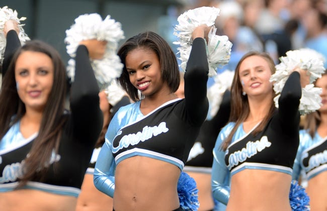 Nov 23, 2013; Chapel Hill, NC, USA; North Carolina Tar Heels dancers perform during the second half against the Old Dominion Monarchs at Kenan Memorial Stadium. The Tar Heels won 80-20.  Mandatory Credit: Rob Kinnan-USA TODAY Sports