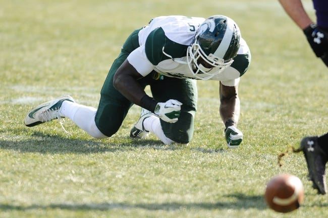 Nov 23, 2013; Evanston, IL, USA; Michigan State Spartans linebacker Taiwan Jones (34) reacts after missing an interception opportunity against the Northwestern Wildcats at Ryan Field. Michigan State won 30-6. Mandatory Credit: Reid Compton-USA TODAY Sports