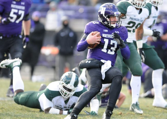 Nov 23, 2013; Evanston, IL, USA; Northwestern Wildcats quarterback Trevor Siemian (13) rushes the ball during the second half against the Michigan State Spartans at Ryan Field. Michigan State won 30-6. Mandatory Credit: Reid Compton-USA TODAY Sports