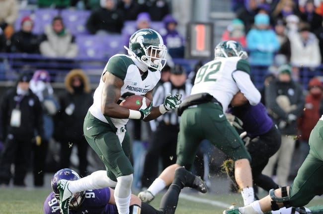 Nov 23, 2013; Evanston, IL, USA; Michigan State Spartans running back Delton Williams (22) rushes the ball during the second half against the Northwestern Wildcats at Ryan Field. Michigan State won 30-6. Mandatory Credit: Reid Compton-USA TODAY Sports