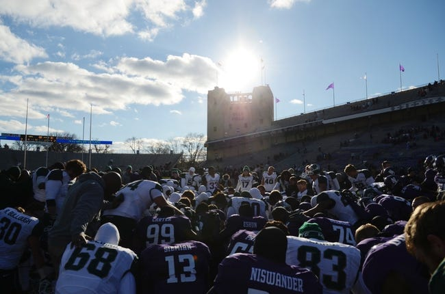 Nov 23, 2013; Evanston, IL, USA; Michigan State Spartans and Northwestern Wildcats players gather at the center of the field after the game at Ryan Field. Michigan State won 30-6. Mandatory Credit: Reid Compton-USA TODAY Sports