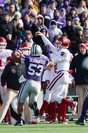 Nov 23, 2013; Manhattan, KS, USA; Oklahoma Sooners quarterback Trevor Knight (9) attempts a pass while being defended by Kansas State Wildcats linebacker Blake Slaughter (53) during the second half at Bill Snyder Family Stadium. The Sooners won 41-31. Mandatory Credit: Jasen Vinlove-USA TODAY Sports