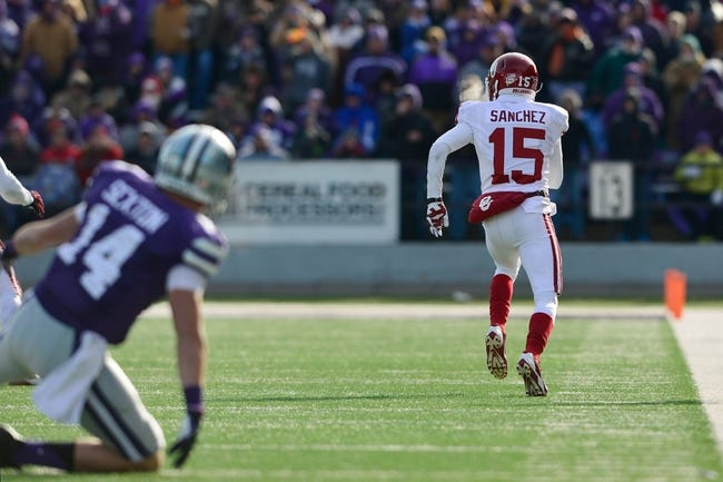 Nov 23, 2013; Manhattan, KS, USA; Oklahoma Sooners defensive back Zack Sanchez (15) scores a touchdown on an interception against the Oklahoma Sooners during the second half at Bill Snyder Family Stadium. The Sooners won 41-31. Mandatory Credit: Jasen Vinlove-USA TODAY Sports