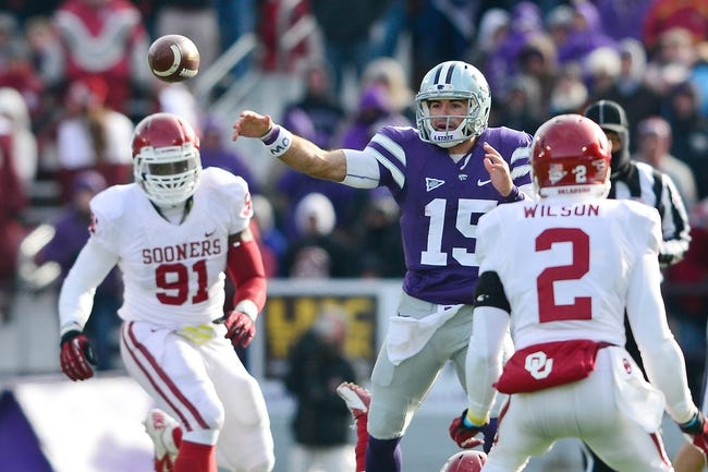 Nov 23, 2013; Manhattan, KS, USA; Kansas State Wildcats quarterback Jake Waters (15) throws a pass against the Oklahoma Sooners during the second half at Bill Snyder Family Stadium. The Sooners won 41-31. Mandatory Credit: Jasen Vinlove-USA TODAY Sports