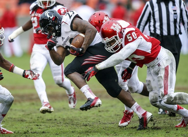 Nov 23, 2013; Houston, TX, USA; Cincinnati Bearcats running back Hosey Williams (23) runs with the ball as Houston Cougars linebacker Efrem Oliphant (50) attempts to make a tackle during the second quarter at BBVA Compass Stadium. Mandatory Credit: Troy Taormina-USA TODAY Sports