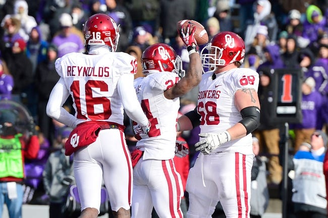 Nov 23, 2013; Manhattan, KS, USA; Oklahoma Sooners running back Brennan Clay (center) celebrates with teammates after scoring a touchdown against the Kansas State Wildcats during the second half at Bill Snyder Family Stadium. The Sooners won 41-31. Mandatory Credit: Jasen Vinlove-USA TODAY Sports