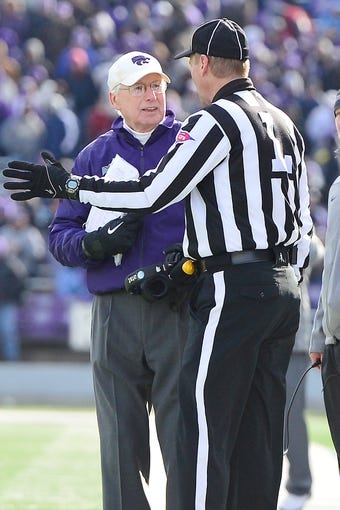 Nov 23, 2013; Manhattan, KS, USA; Kansas State Wildcats head coach Bill Snyder talks to the line judge David Oliver during the second half against the Oklahoma Sooners at Bill Snyder Family Stadium. The Sooners won 41-31. Mandatory Credit: Jasen Vinlove-USA TODAY Sports