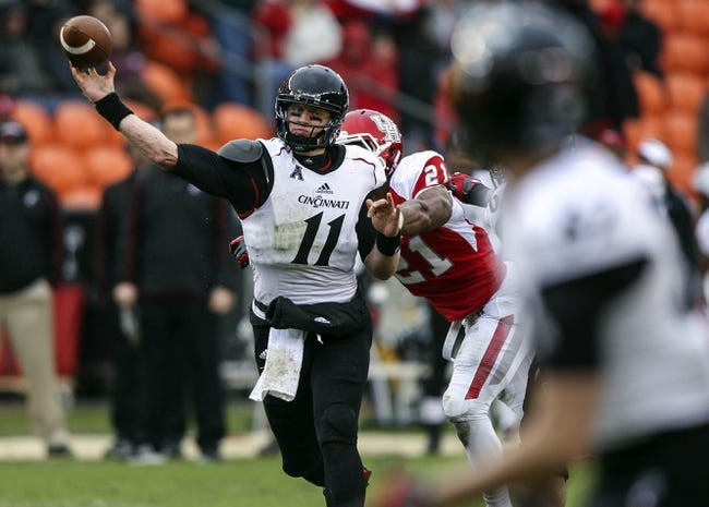 Nov 23, 2013; Houston, TX, USA; Cincinnati Bearcats quarterback Brendon Kay (11) attempts a pass during the second quarter against the Houston Cougars at BBVA Compass Stadium. The Bearcats defeated the Cougars 24-17. Mandatory Credit: Troy Taormina-USA TODAY Sports