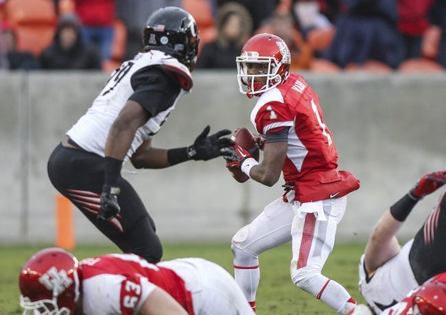 Nov 23, 2013; Houston, TX, USA; Houston Cougars quarterback Greg Ward Jr. (1) looks for an open receiver during the third quarter against the Cincinnati Bearcats at BBVA Compass Stadium. The Bearcats defeated the Cougars 24-17. Mandatory Credit: Troy Taormina-USA TODAY Sports