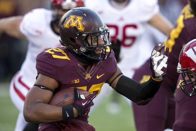 Nov 23, 2013; Minneapolis, MN, USA; Minnesota Golden Gophers running back David Cobb (27) rushes with the ball in the first quarter against the Wisconsin Badgers at TCF Bank Stadium. Mandatory Credit: Jesse Johnson-USA TODAY Sports