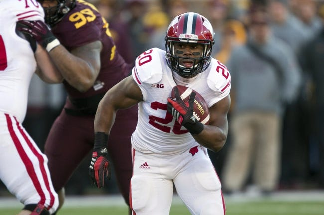 Nov 23, 2013; Minneapolis, MN, USA; Wisconsin Badgers running back James White (20) rushes with the ball in the first quarter against the Minnesota Golden Gophers at TCF Bank Stadium. Mandatory Credit: Jesse Johnson-USA TODAY Sports