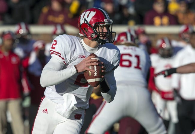 Nov 23, 2013; Minneapolis, MN, USA; Wisconsin Badgers quarterback Joel Stave (2) drops back for a pass in the first quarter against the Minnesota Golden Gophers at TCF Bank Stadium. Mandatory Credit: Jesse Johnson-USA TODAY Sports