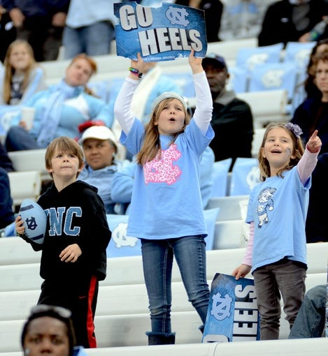 Nov 23, 2013; Chapel Hill, NC, USA; North Carolina Tar Heels fans cheer during the second half against the Old Dominion Monarchs at Kenan Memorial Stadium. The Tar Heels won 80-20.  Mandatory Credit: Rob Kinnan-USA TODAY Sports