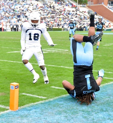 Nov 23, 2013; Chapel Hill, NC, USA; North Carolina Tar Heels running back Khris Francis (1) lands on his head after a run during the second half against the Old Dominion Monarchs at Kenan Memorial Stadium. The Tar Heels won 80-20.  Mandatory Credit: Rob Kinnan-USA TODAY Sports