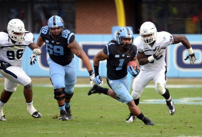 Nov 23, 2013; Chapel Hill, NC, USA; North Carolina Tar Heels running back Khris Francis (1) runs against the Old Dominion Monarchs as defender Scott Wiggins (94) pursues  during the second half at Kenan Memorial Stadium. The Tar Heels won 80-20.  Mandatory Credit: Rob Kinnan-USA TODAY Sports