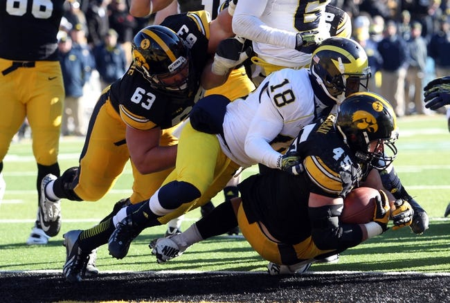 Nov 23, 2013; Iowa City, IA, USA; Michigan Wolverines cornerback Blake Countless (18) tackles Iowa Hawkeyes running back Mark Weisman (45) in the end zone  at Kinnick Stadium. Iowa beat Michigan 24-21.  Mandatory Credit: Reese Strickland-USA TODAY Sports