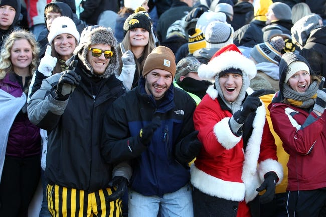 Nov 23, 2013; Iowa City, IA, USA;   Iowa Hawkeyes fans celebrate after their win over the Michigan Wolverines at Kinnick Stadium. Iowa beat Michigan 24-21.  Mandatory Credit: Reese Strickland-USA TODAY Sports
