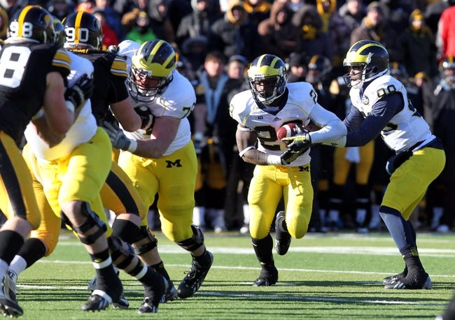 Nov 23, 2013; Iowa City, IA, USA;  Michigan Wolverines running back Fitzgerald Toussaint (28)  runs the football against the Iowa Hawkeyes at Kinnick Stadium. Iowa beat Michigan 24-21.  Mandatory Credit: Reese Strickland-USA TODAY Sports