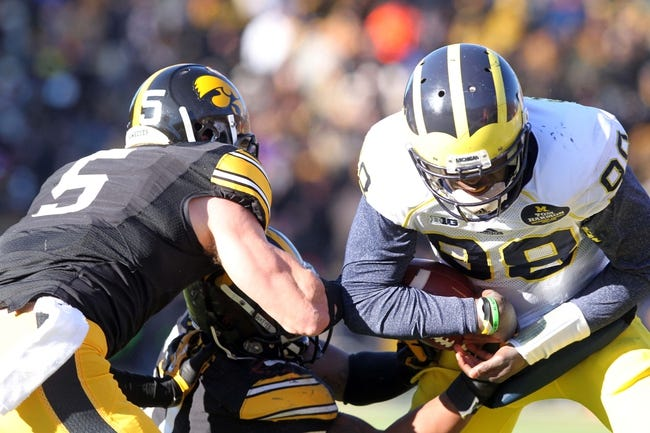 Nov 23, 2013; Iowa City, IA, USA;  Michigan Wolverines quarterback Devin Gardner (98) loses the ball to Iowa Hawkeyes defender Anthony Hitchens (31) at Kinnick Stadium. Iowa beat Michigan 24-21.  Mandatory Credit: Reese Strickland-USA TODAY Sports