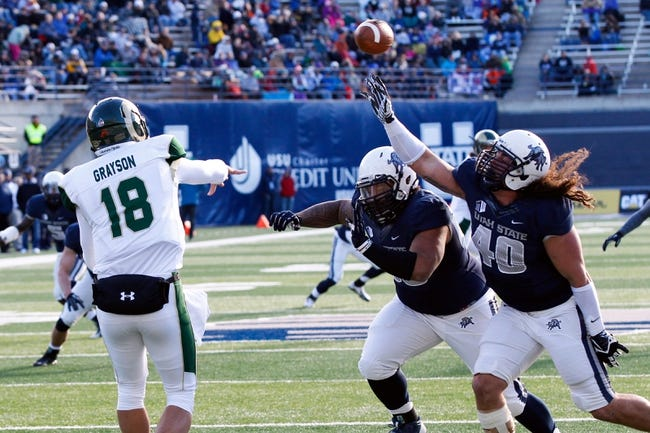 Nov 23, 2013; Logan, UT, USA; Utah State Aggies defensive end Connor Williams (40) tries to block a pass from Colorado State Rams quarterback Garrett Grayson (18) during the first quarter at Romney Stadium. Mandatory Credit: Chris Nicoll-USA TODAY Sports