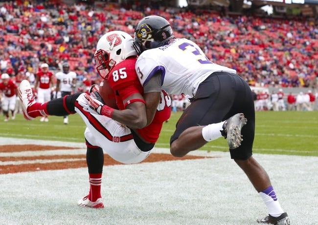Nov 23, 2013; Raleigh, NC, USA; North Carolina State Wolfpack wide receiver Jumichael Ramos (85) catches a 4th quarter touchdown pass in front of East Carolina Pirates defensive back Adonis Armstrong (3) at Carter Finley Stadium. The East Carolina Pirates defeated the North Carolina State Wolfpack 42-28. Mandatory Credit: James Guillory-USA TODAY Sports
