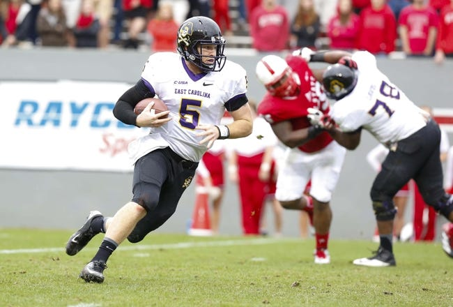 Nov 23, 2013; Raleigh, NC, USA; East Carolina Pirates quarterback Shane Carden (5) carries the ball against the North Carolina State Wolfpack at Carter Finley Stadium. The East Carolina Pirates defeated the North Carolina State Wolfpack 42-28. Mandatory Credit: James Guillory-USA TODAY Sports