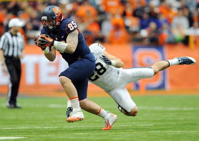 Nov 23, 2013; Syracuse, NY, USA; Syracuse Orange tight end Beckett Wales (85) makes a catch in front of Pittsburgh Panthers linebacker Anthony Gonzalez (28) during the third quarter at the Carrier Dome.  Pittsburgh defeated Syracuse 17-16.  Mandatory Credit: Rich Barnes-USA TODAY Sports