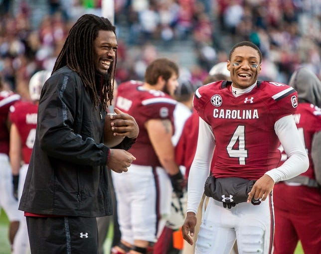 Nov 23, 2013; Columbia, SC, USA; South Carolina Gamecocks defensive end Jadeveon Clowney (left) and wide receiver Shaq Roland (4) joke around in the second half against the Coastal Carolina Chanticleers at Williams-Brice Stadium. Mandatory Credit: Jeff Blake-USA TODAY