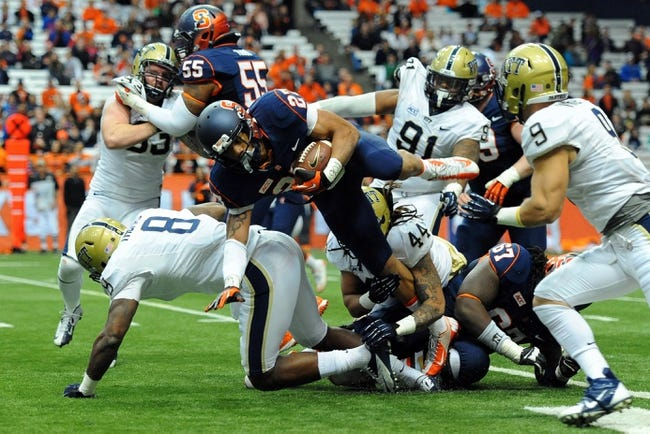Nov 23, 2013; Syracuse, NY, USA; Syracuse Orange running back George Morris II (27) is tackled from behind by Pittsburgh Panthers linebacker Shane Gordon (44) while attempting to leap over Panthers linebacker Todd Thomas (8) during the fourth quarter at the Carrier Dome.  Pittsburgh defeated Syracuse 17-16.  Mandatory Credit: Rich Barnes-USA TODAY Sports