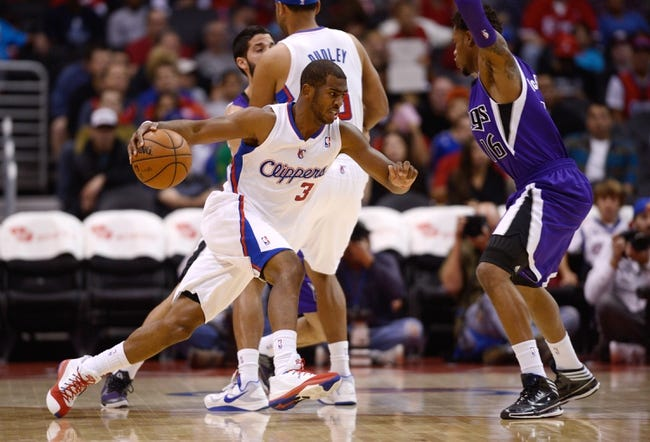 Nov 23, 2013; Los Angeles, CA, USA; Los Angeles Clippers guard Chris Paul (3) drives the ball defended by Sacramento Kings guard Ben McLemore (16) during the first period at Staples Center. Mandatory Credit: Kelvin Kuo-USA TODAY Sports