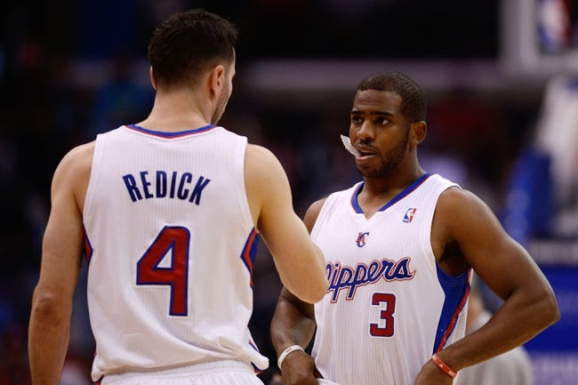Nov 23, 2013; Los Angeles, CA, USA; Los Angeles Clippers guard Chris Paul (3) and Los Angeles Clippers guard J.J. Reddick (4) talk prior to the start of the game between the Sacramento Kings and Los Angeles Clippers at Staples Center. Mandatory Credit: Kelvin Kuo-USA TODAY Sports