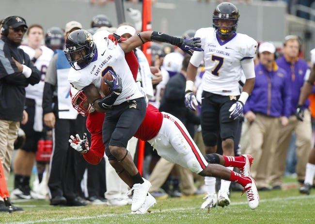 Nov 23, 2013; Raleigh, NC, USA; East Carolina Pirates wide receiver Justin Hardy (2) carries the ball after a catch against the North Carolina State Wolfpack at Carter Finley Stadium. The East Carolina Pirates defeated the North Carolina State Wolfpack 42-28. Mandatory Credit: James Guillory-USA TODAY Sports