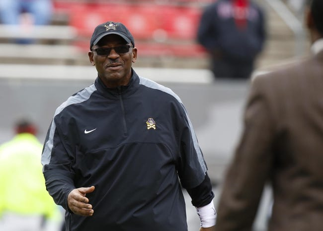 Nov 23, 2013; Raleigh, NC, USA; East Carolina Pirates head coach Ruffin McNeill reacts before the start of the game against the North Carolina State Wolfpack at Carter Finley Stadium. The East Carolina Pirates defeated the North Carolina State Wolfpack 42-28. Mandatory Credit: James Guillory-USA TODAY Sports