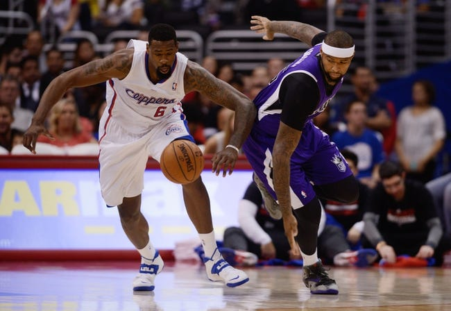 Nov 23, 2013; Los Angeles, CA, USA; Sacramento Kings center DeMarcus Cousins (15) attempts to steal the ball from Los Angeles Clippers center DeAndre Jordan (6) during the first quarter at Staples Center. Mandatory Credit: Kelvin Kuo-USA TODAY Sports