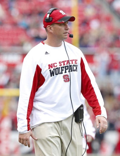 Nov 23, 2013; Raleigh, NC, USA; North Carolina State Wolfpack head coach Dave Doeren looks on against the East Carolina Pirates at Carter Finley Stadium. The East Carolina Pirates defeated the North Carolina State Wolfpack 42-28. Mandatory Credit: James Guillory-USA TODAY Sports