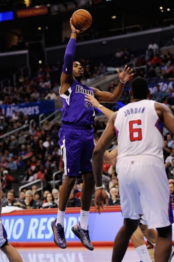 Nov 23, 2013; Los Angeles, CA, USA; Sacramento Kings forward Jason Thompson (34) attempts a shot against the Los Angeles Clippers during the first quarter at Staples Center. Mandatory Credit: Kelvin Kuo-USA TODAY Sports