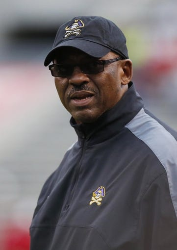 Nov 23, 2013; Raleigh, NC, USA; East Carolina Pirates head coach Ruffin McNeill looks on against the North Carolina State Wolfpack at Carter Finley Stadium. The East Carolina Pirates defeated the North Carolina State Wolfpack 42-28. Mandatory Credit: James Guillory-USA TODAY Sports