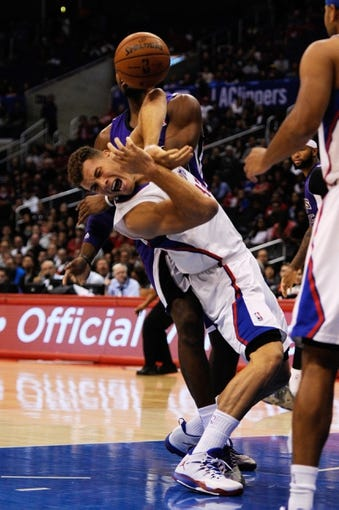 Nov 23, 2013; Los Angeles, CA, USA; Los Angeles Clippers forward Blake Griffin (32) and Sacramento Kings forward Jason Thompson (34) battle for the rebound during the first period at Staples Center. Mandatory Credit: Kelvin Kuo-USA TODAY Sports