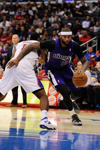 Nov 23, 2013; Los Angeles, CA, USA; Sacramento Kings center DeMarcus Cousins (15) drives the ball defended by Los Angeles Clippers center DeAndre Jordan (6) during the first quarter at Staples Center. Mandatory Credit: Kelvin Kuo-USA TODAY Sports