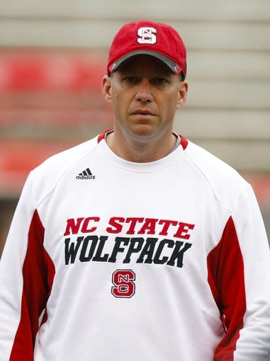 Nov 23, 2013; Raleigh, NC, USA; North Carolina State Wolfpack head coach Dave Doeren before the start of the game against the East Carolina Pirates at Carter Finley Stadium. The East Carolina Pirates defeated the North Carolina State Wolfpack 42-28. Mandatory Credit: James Guillory-USA TODAY Sports