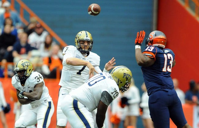 Nov 23, 2013; Syracuse, NY, USA; Pittsburgh Panthers quarterback Tom Savage (7) passes the ball around the defense of Syracuse Orange defensive end Ron Thompson (13) during the first quarter at the Carrier Dome.  Pittsburgh defeated Syracuse 17-16.  Mandatory Credit: Rich Barnes-USA TODAY Sports