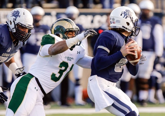 Nov 23, 2013; Logan, UT, USA; Utah State Aggies quarterback Darell Garretson (6) is sacked by Colorado State Rams linebacker Cory James (31) during the second quarter at Romney Stadium. Mandatory Credit: Chris Nicoll-USA TODAY Sports