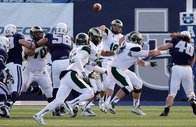 Nov 23, 2013; Logan, UT, USA; Colorado State Rams quarterback Garrett Grayson (18) throws the ball to wide receiver Rashard Higgins (82) in the second quarter in the game against the Utah State Aggies at Romney Stadium. Mandatory Credit: Chris Nicoll-USA TODAY Sports