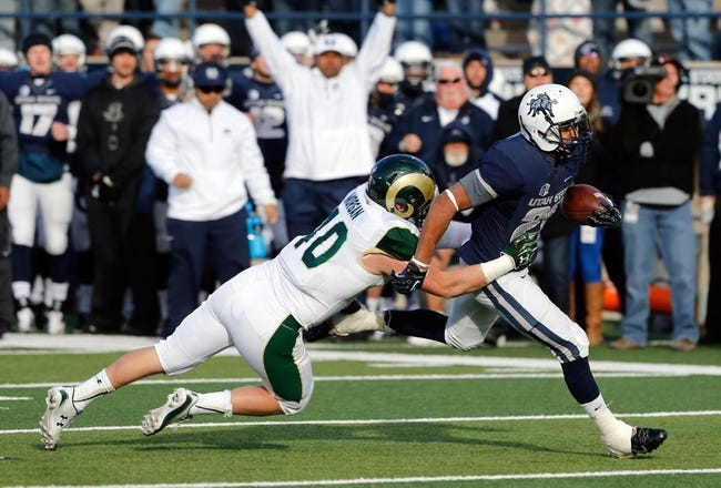 Nov 23, 2013; Logan, UT, USA; Colorado State Rams linebacker Max Morgan (40) stops Utah State Aggies running back Joey DeMartino (28) during the second quarter at Romney Stadium. Mandatory Credit: Chris Nicoll-USA TODAY Sports